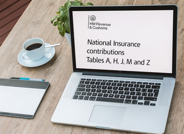 laptop with National Insurance information on screen