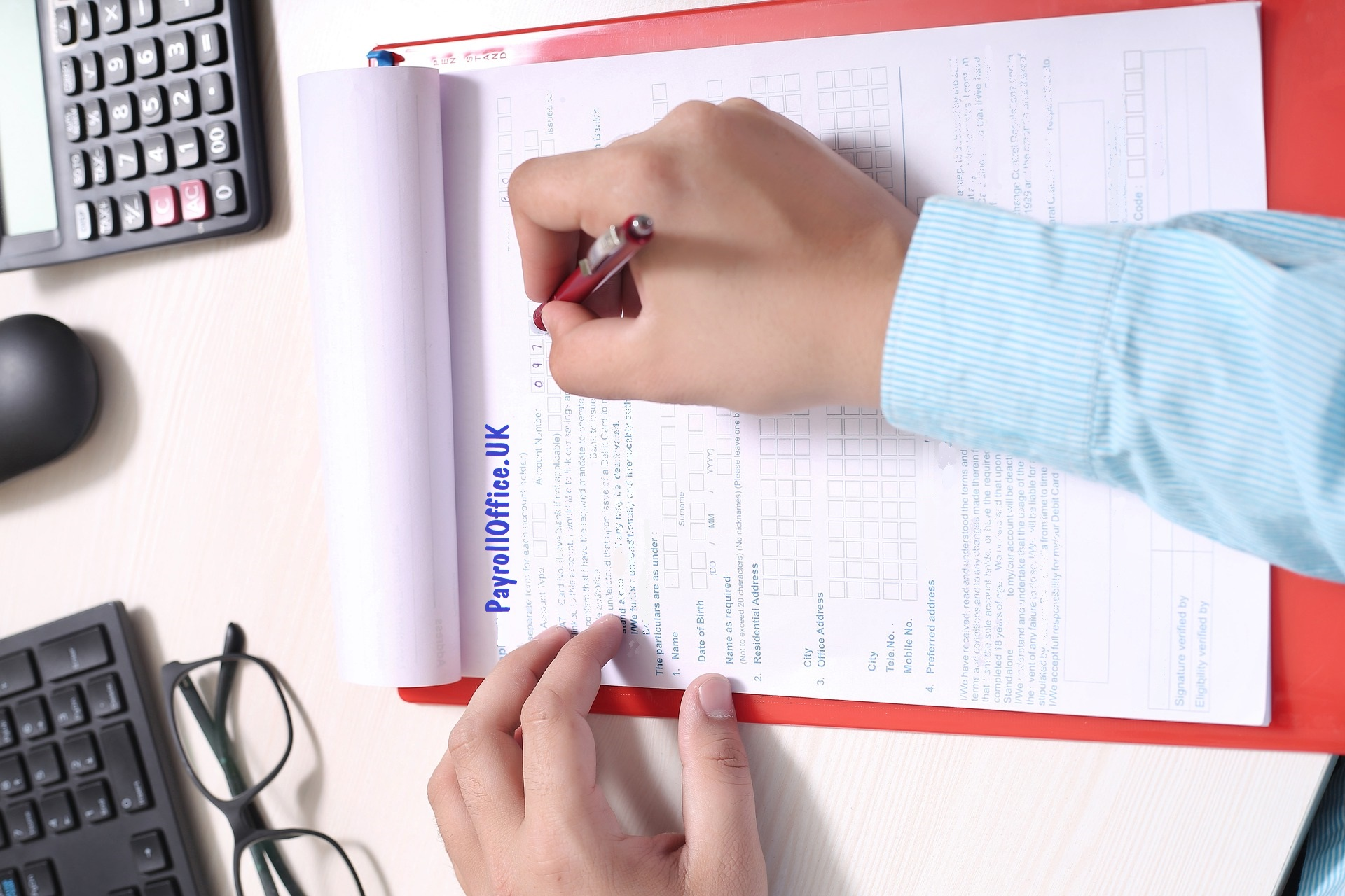 image someone completing a PayrollOfficeUK form by hand